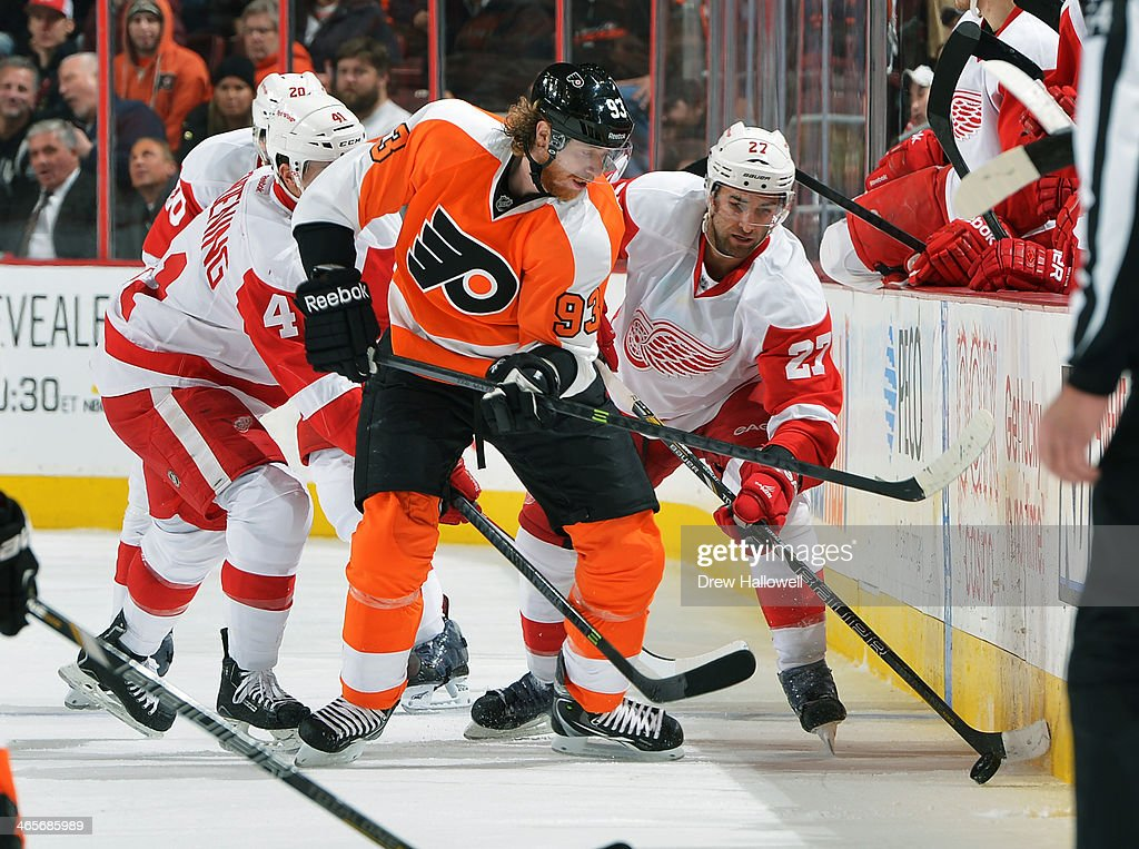 <a gi-track='captionPersonalityLinkClicked' href=/galleries/search?phrase=Jakub+Voracek&family=editorial&specificpeople=4111797 ng-click='$event.stopPropagation()'>Jakub Voracek</a> #93 of the Philadelphia Flyers and <a gi-track='captionPersonalityLinkClicked' href=/galleries/search?phrase=Kyle+Quincey&family=editorial&specificpeople=2234340 ng-click='$event.stopPropagation()'>Kyle Quincey</a> #27 of the Detroit Red Wings battle for the puck at the Wells Fargo Center on January 28, 2014 in Philadelphia, Pennsylvania. The Flyers won 5-0.