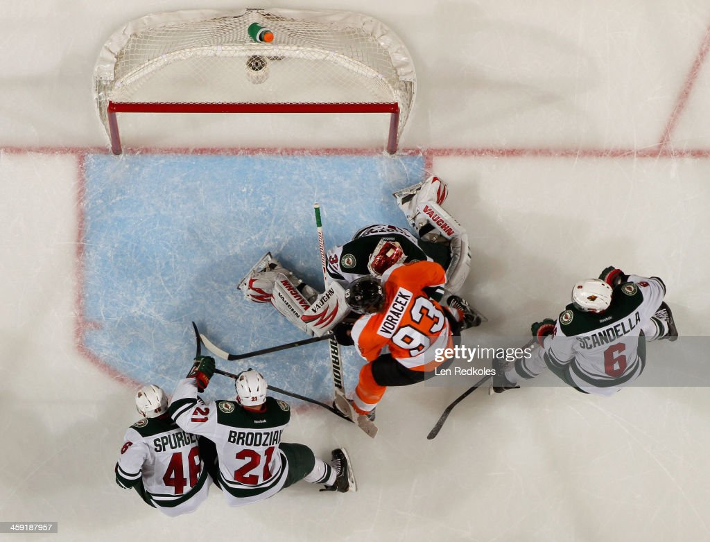 <a gi-track='captionPersonalityLinkClicked' href=/galleries/search?phrase=Jakub+Voracek&family=editorial&specificpeople=4111797 ng-click='$event.stopPropagation()'>Jakub Voracek</a> #93 of the Philadelphia Flyers attempts a scoring chance in front of Niklas Backstrom #32 of the Minnesota Wild while being defended by <a gi-track='captionPersonalityLinkClicked' href=/galleries/search?phrase=Jared+Spurgeon&family=editorial&specificpeople=4594192 ng-click='$event.stopPropagation()'>Jared Spurgeon</a> #46, <a gi-track='captionPersonalityLinkClicked' href=/galleries/search?phrase=Kyle+Brodziak&family=editorial&specificpeople=2165412 ng-click='$event.stopPropagation()'>Kyle Brodziak</a> #21 and <a gi-track='captionPersonalityLinkClicked' href=/galleries/search?phrase=Marco+Scandella&family=editorial&specificpeople=5408903 ng-click='$event.stopPropagation()'>Marco Scandella</a> #6 on December 23, 2013 at the Wells Fargo Center in Philadelphia, Pennsylvania. The Flyers defeated the Wild 4-1.