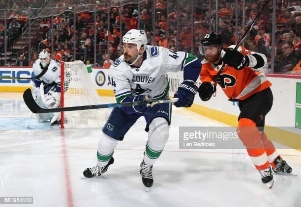 Jakub Voracek of the Philadelphia Flyers battles against Erik Gudbranson of the Vancouver Canucks on November 21 2017 at the Wells Fargo Center in...