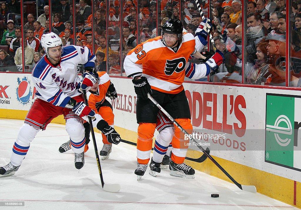Jakub Voracek of the Philadelphia Flyers battles for the puck against Steve Eminger of the New York Rangers on March 26 2013 at the Wells Fargo...