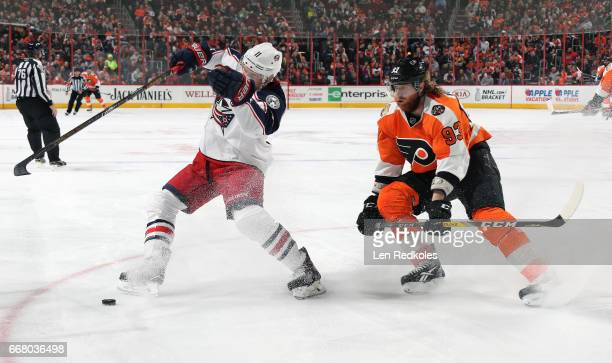 Jakub Voracek of the Philadelphia Flyers battles for the puck against Zach Werenski of the Columbus Blue Jackets on April 8 2017 at the Wells Fargo...