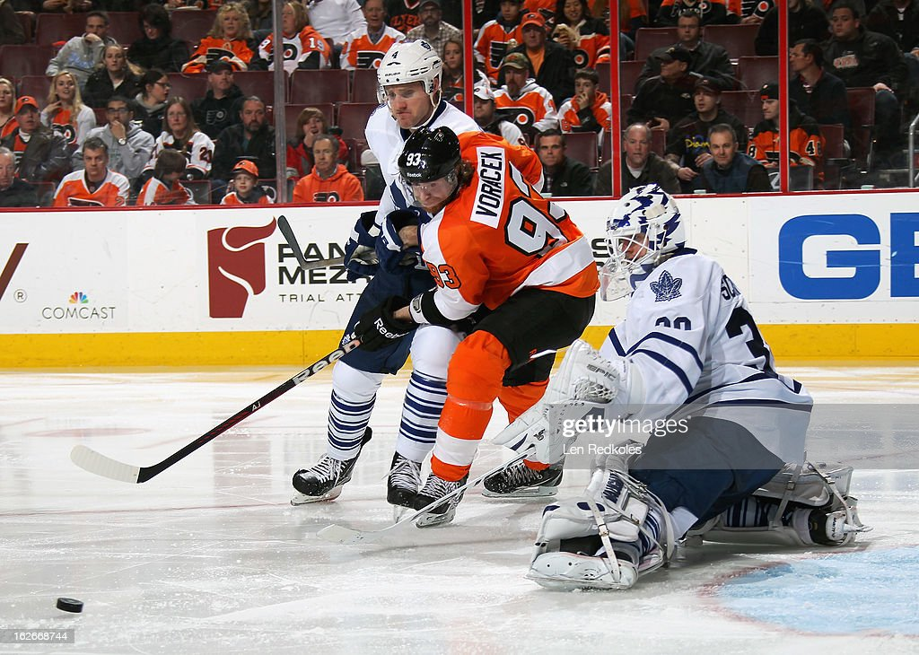 Jakub Voracek #93 of the Philadelphia Flyers battles with Cody Franson #4 of the Toronto Maple Leafs in front of goaltender Ben Scrivens #30 on February 25, 2013 at the Wells Fargo Center in Philadelphia, Pennsylvania. The Maple Leafs went on to defeat the Flyers 4-2.