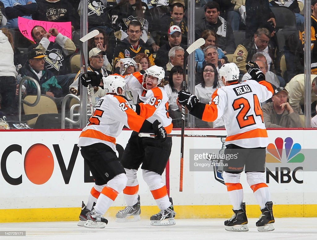 <a gi-track='captionPersonalityLinkClicked' href=/galleries/search?phrase=Jakub+Voracek&family=editorial&specificpeople=4111797 ng-click='$event.stopPropagation()'>Jakub Voracek</a> #93 of the Philadelphia Flyers celebrates his game winning goal with <a gi-track='captionPersonalityLinkClicked' href=/galleries/search?phrase=Matt+Carle&family=editorial&specificpeople=582495 ng-click='$event.stopPropagation()'>Matt Carle</a> #25 and <a gi-track='captionPersonalityLinkClicked' href=/galleries/search?phrase=Matt+Read&family=editorial&specificpeople=6783206 ng-click='$event.stopPropagation()'>Matt Read</a> #24 against the Pittsburgh Penguins in Game One of the Eastern Conference Quarterfinals during the 2012 NHL Stanley Cup Playoffs at Consol Energy Center on April 11, 2012 in Pittsburgh, Pennsylvania. Philadelphia won 4-3 in overtime.