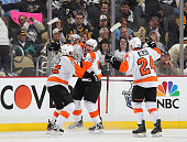 Jakub Voracek of the Philadelphia Flyers celebrates his game winning goal with Matt Carle and Matt Read against the Pittsburgh Penguins in Game One...