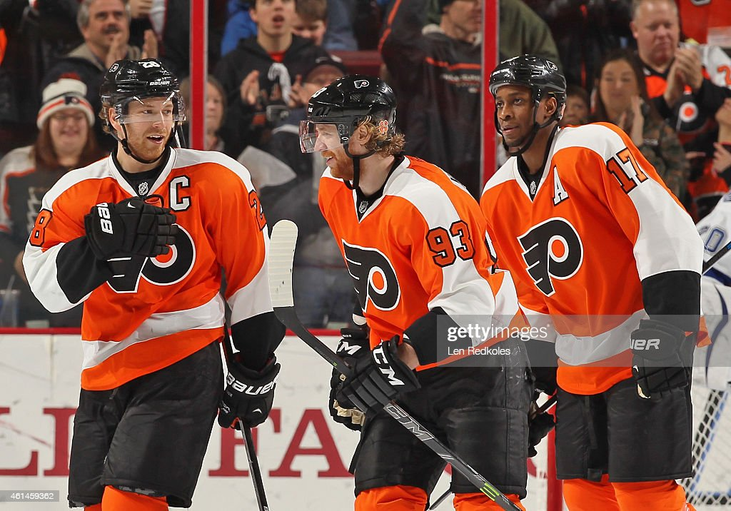 Jakub Voracek of the Philadelphia Flyers celebrates his second period powerplay goal against the Tampa Bay Lightning with teammates Claude Giroux and...
