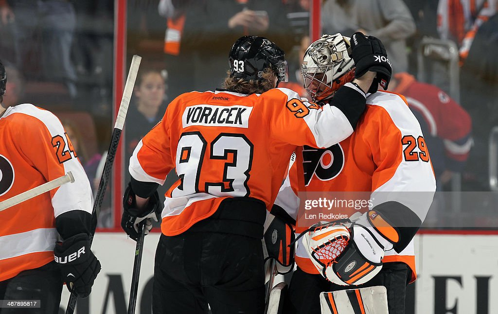 <a gi-track='captionPersonalityLinkClicked' href=/galleries/search?phrase=Jakub+Voracek&family=editorial&specificpeople=4111797 ng-click='$event.stopPropagation()'>Jakub Voracek</a> #93 of the Philadelphia Flyers congratulates <a gi-track='captionPersonalityLinkClicked' href=/galleries/search?phrase=Ray+Emery&family=editorial&specificpeople=218109 ng-click='$event.stopPropagation()'>Ray Emery</a> on a 2-1 win over the Calgary Flames on February 8, 2014 at the Wells Fargo Center in Philadelphia, Pennsylvania.