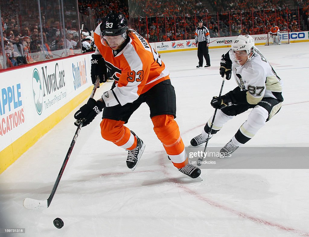 Jakub Voracek #93 of the Philadelphia Flyers controls the puck in the corner while being pursued by Sidney Crosby #87 of the Pittsburgh Penguins on January 19, 2013 at the Wells Fargo Center in Philadelphia, Pennsylvania. The Penguins went on to defeat the Flyers 3-1.