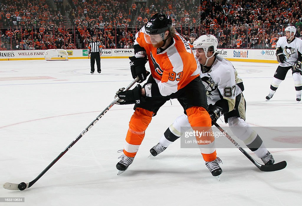 Jakub Voracek #93 of the Philadelphia Flyers controls the puck while being pursued by Sidney Crosby #87 of the Pittsburgh Penguins on March 7, 2013 at the Wells Fargo Center in Philadelphia, Pennsylvania. The Penguins went on to defeat the Flyers 5-4.