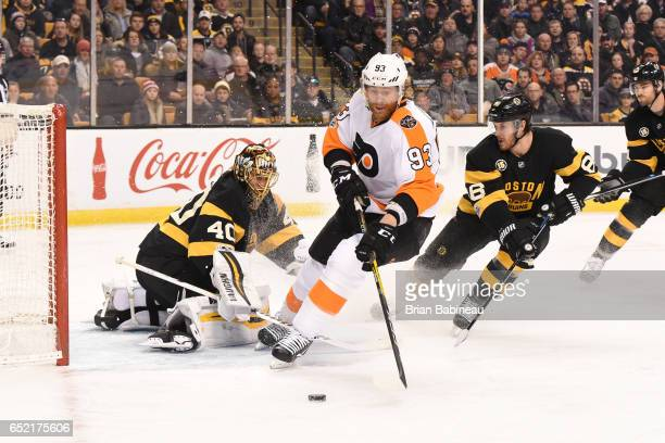Jakub Voracek of the Philadelphia Flyers fights for the puck against Tuukka Rask of the Boston Bruins at the TD Garden on March 11 2017 in Boston...