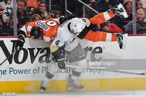 Jakub Voracek of the Philadelphia Flyers gets upended by Rob Scuderi of the Pittsburgh Penguins at the Wells Fargo Center on January 20 2015 in...