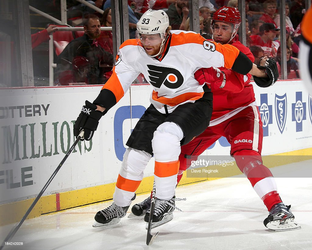 <a gi-track='captionPersonalityLinkClicked' href=/galleries/search?phrase=Jakub+Voracek&family=editorial&specificpeople=4111797 ng-click='$event.stopPropagation()'>Jakub Voracek</a> #93 of the Philadelphia Flyers goes into the corner for the puck as <a gi-track='captionPersonalityLinkClicked' href=/galleries/search?phrase=Kyle+Quincey&family=editorial&specificpeople=2234340 ng-click='$event.stopPropagation()'>Kyle Quincey</a> #27 of the Detroit Red Wings puts a body on him during a NHL game at Joe Louis Arena on October 12, 2013 in Detroit, Michigan.