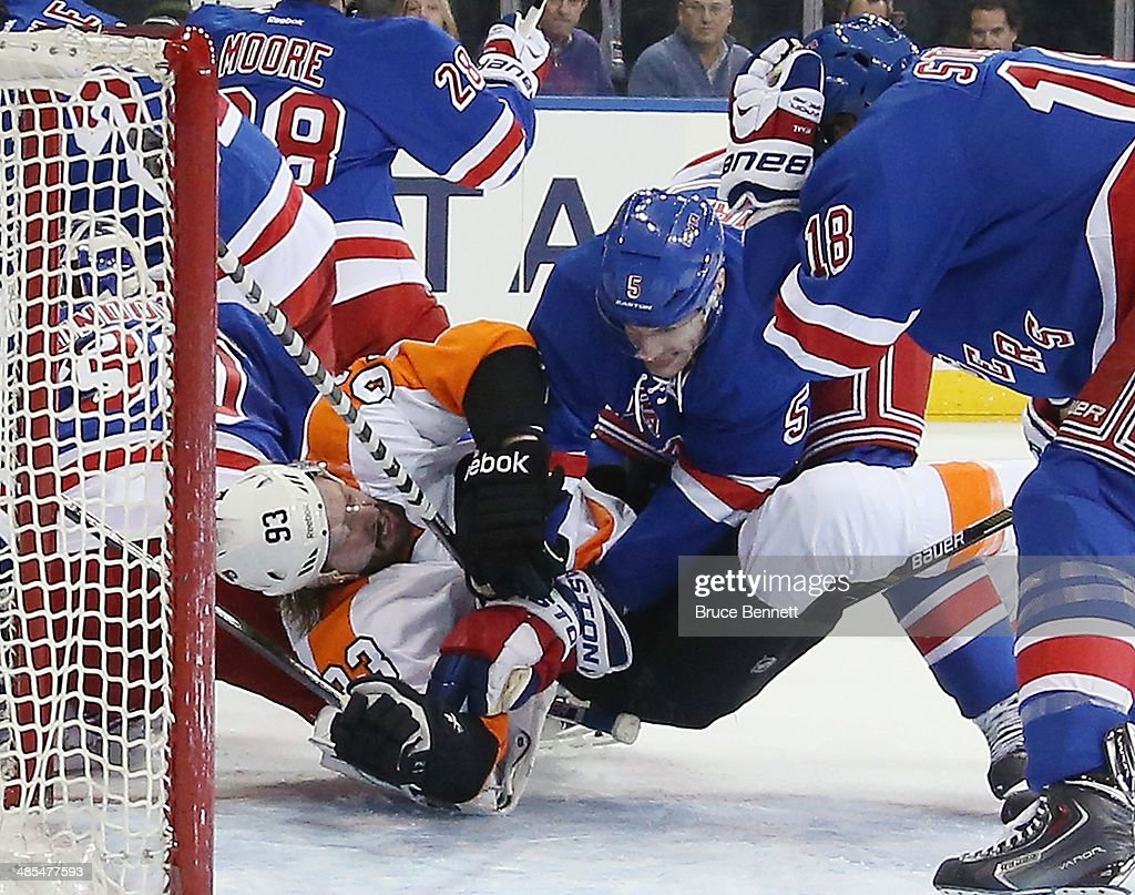 <a gi-track='captionPersonalityLinkClicked' href=/galleries/search?phrase=Jakub+Voracek&family=editorial&specificpeople=4111797 ng-click='$event.stopPropagation()'>Jakub Voracek</a> #93 of the Philadelphia Flyers is hit by Dan Girardi #5 of the New York Rangers in Game One of the First Round of the 2014 NHL Stanley Cup Playoffs at Madison Square Garden on April 17, 2014 in New York City. 1nc0m1ngF1eld