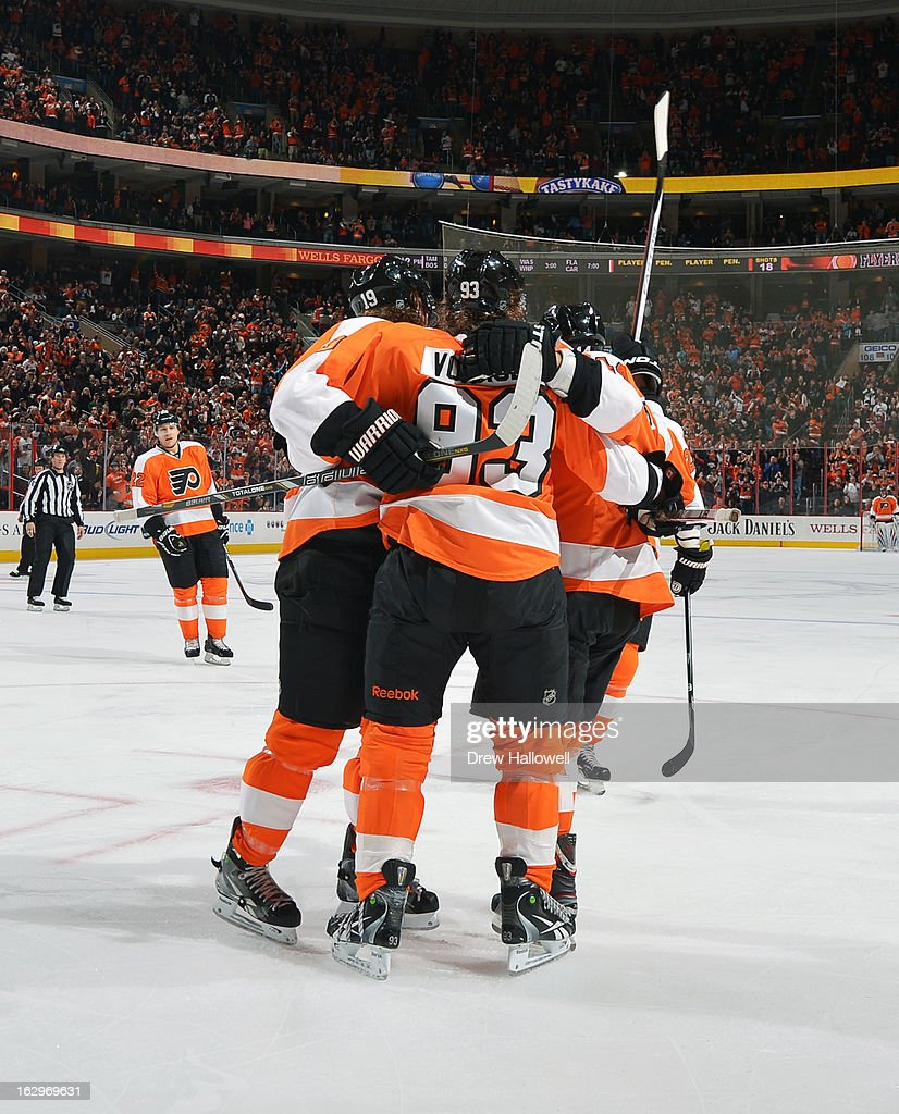 <a gi-track='captionPersonalityLinkClicked' href=/galleries/search?phrase=Jakub+Voracek&family=editorial&specificpeople=4111797 ng-click='$event.stopPropagation()'>Jakub Voracek</a> #93 of the Philadelphia Flyers is hugged by teammates after scoring a goal during the game against the Ottawa Senators at the Wells Fargo Center on March 2, 2013 in Philadelphia, Pennsylvania.
