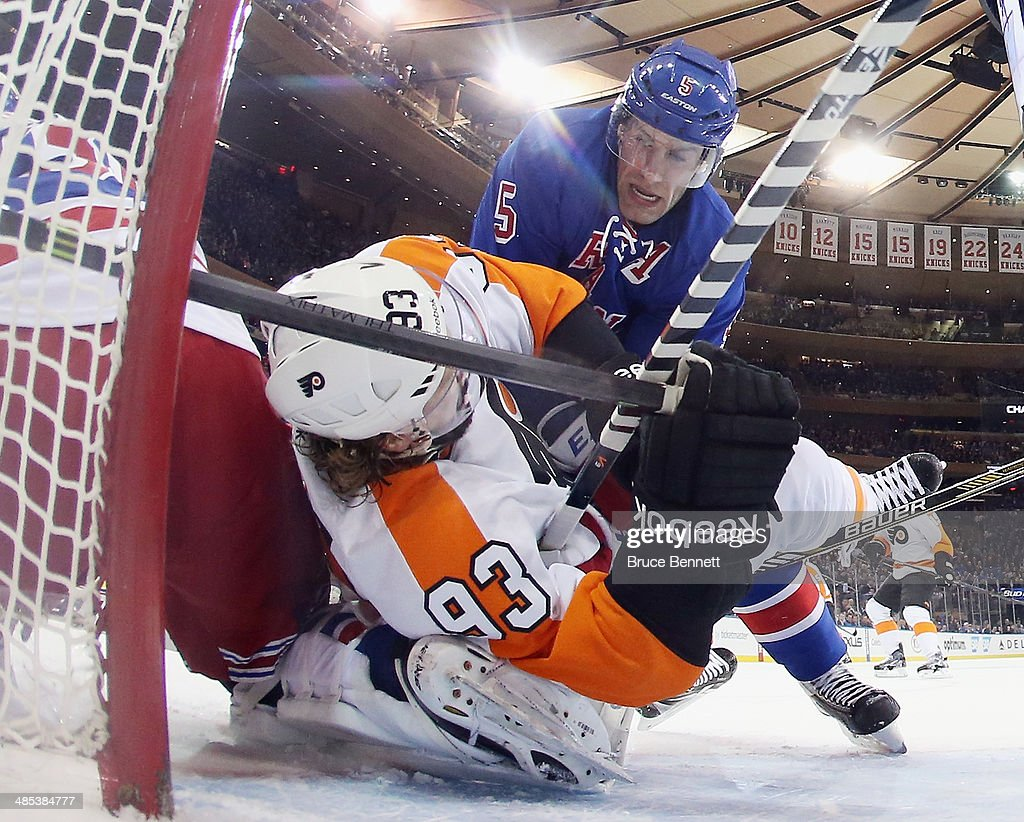 <a gi-track='captionPersonalityLinkClicked' href=/galleries/search?phrase=Jakub+Voracek&family=editorial&specificpeople=4111797 ng-click='$event.stopPropagation()'>Jakub Voracek</a> #93 of the Philadelphia Flyers is taken down in the crease by Dan Girardi #5 of the New York Rangers during the first period in Game One of the First Round of the 2014 NHL Stanley Cup Playoffs at Madison Square Garden on April 17, 2014 in New York City.