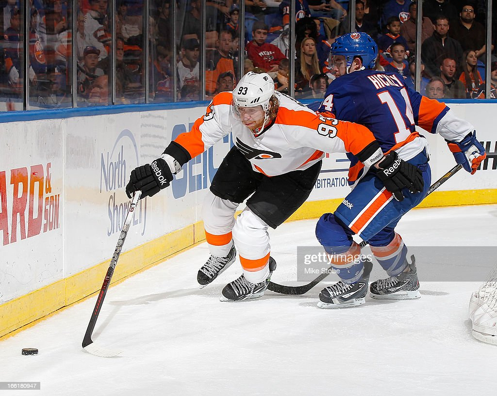 Jakub Voracek #93 of the Philadelphia Flyers lunges for the puck in front of Thomas Hickey #14 of the New York Islanders at Nassau Veterans Memorial Coliseum on April 9, 2013 in Uniondale, New York. The Islanders defeated the Flyers 4-1.