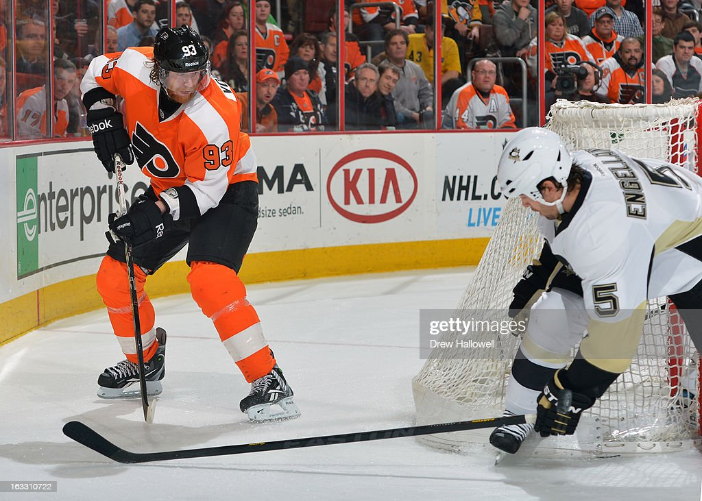 Jakub Voracek #93 of the Philadelphia Flyers passes the puck past Deryk Engelland #5 of the Pittsburgh Penguins at the Wells Fargo Center on March 7, 2013 in Philadelphia, Pennsylvania. The Penguins won 5-4.