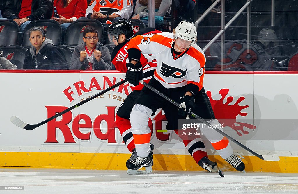 <a gi-track='captionPersonalityLinkClicked' href=/galleries/search?phrase=Jakub+Voracek&family=editorial&specificpeople=4111797 ng-click='$event.stopPropagation()'>Jakub Voracek</a> #93 of the Philadelphia Flyers plays the puck away from <a gi-track='captionPersonalityLinkClicked' href=/galleries/search?phrase=Anton+Volchenkov&family=editorial&specificpeople=210890 ng-click='$event.stopPropagation()'>Anton Volchenkov</a> #28 of the New Jersey Devils during the game at the Prudential Center on November 2, 2013 in Newark, New Jersey.