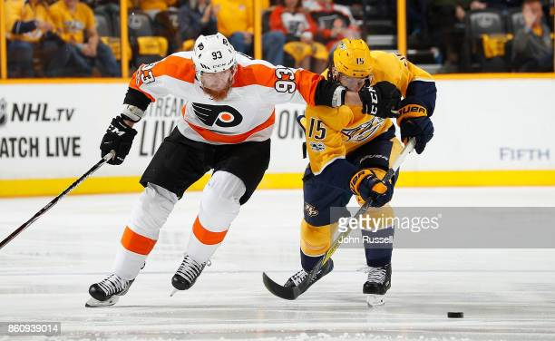 Jakub Voracek of the Philadelphia Flyers skates against Craig Smith of the Nashville Predators during an NHL game at Bridgestone Arena on October 10...