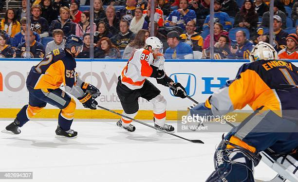Jakub Voracek of the Philadelphia Flyers skates around Alexander Sulzer of the Buffalo Sabres towards Jhonas Enroth of the Sabres on January 14 2014...