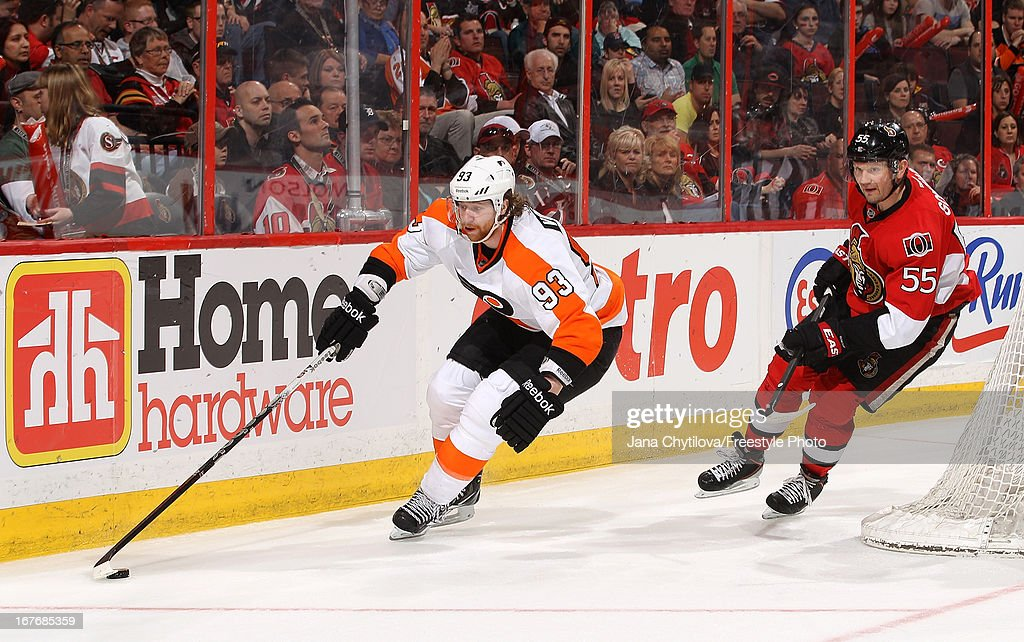 <a gi-track='captionPersonalityLinkClicked' href=/galleries/search?phrase=Jakub+Voracek&family=editorial&specificpeople=4111797 ng-click='$event.stopPropagation()'>Jakub Voracek</a> #93 of the Philadelphia Flyers skates with the puck as <a gi-track='captionPersonalityLinkClicked' href=/galleries/search?phrase=Sergei+Gonchar&family=editorial&specificpeople=202470 ng-click='$event.stopPropagation()'>Sergei Gonchar</a> #55 chases after him, during an NHL game, at Scotiabank Place, on April 27, 2013 in Ottawa, Ontario, Canada.