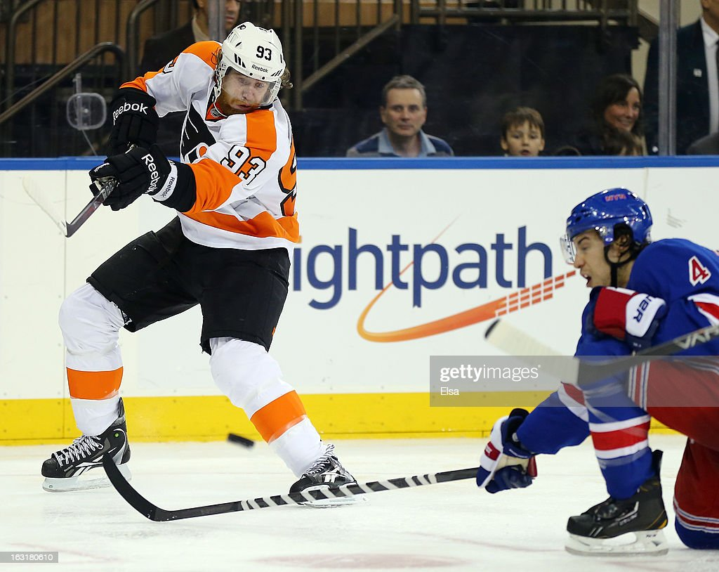 <a gi-track='captionPersonalityLinkClicked' href=/galleries/search?phrase=Jakub+Voracek&family=editorial&specificpeople=4111797 ng-click='$event.stopPropagation()'>Jakub Voracek</a> #93 of the Philadelphia Flyers takes a shot as <a gi-track='captionPersonalityLinkClicked' href=/galleries/search?phrase=Michael+Del+Zotto&family=editorial&specificpeople=4044191 ng-click='$event.stopPropagation()'>Michael Del Zotto</a> #4 of the New York Rangers defends on March 5, 2013 at Madison Square Garden in New York City.The New York Rangers defeated the Philadelphia Flyers 4-2.