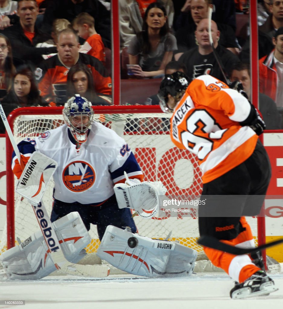 Jakub Voracek #93 of the Philadelphia Flyers takes a shot on goaltender Evgeni Nabokov #20 of the New York Islanders on March 1, 2012 at the Wells Fargo Center in Philadelphia, Pennsylvania.