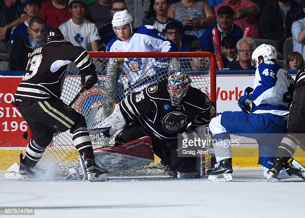 Jakub Vrana and Justin Peters of the Hershey Bears battles for the loose puck with Kasperi Kapanen and Ben Smith of the Toronto Marlies during AHL...