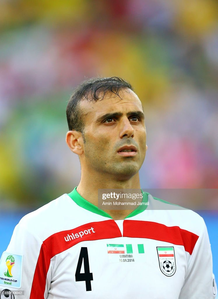 <a gi-track='captionPersonalityLinkClicked' href=/galleries/search?phrase=Jalal+Hosseini&family=editorial&specificpeople=4099109 ng-click='$event.stopPropagation()'>Jalal Hosseini</a> #4 of Iran looks on during the 2014 FIFA World Cup Brazil Group F match between Iran and Nigeria at Arena da Baixada on June 16, 2014 in Curitiba, Brazil.