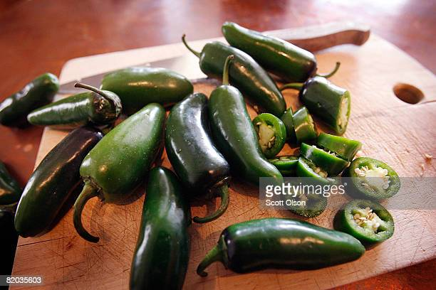 Jalapeno peppers sit on a cutting block July 22 2008 in Chicago Illinois Mexicangrown Jalapeno peppers are now suspected to be responsible for a...