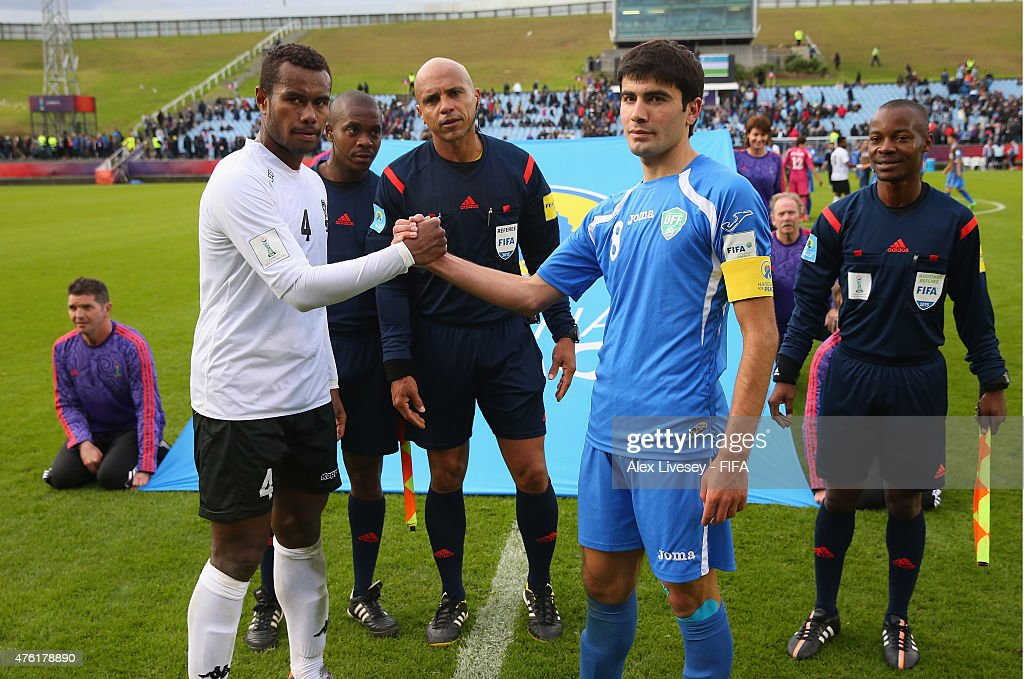 Jale Dreloa of Fiji and Javokhir Sokhibov of Uzbekistan shake hands after the FIFA U-20 World Cup Group F match between Fiji and Uzbekistan at the Northland Events Centre on June 7, 2015 in Whangarei, New Zealand.