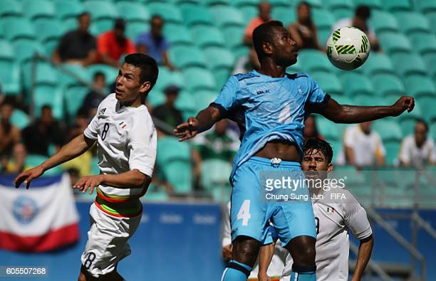 Jale Dreloa of Fiji competes for the ball with Hirving Lozano of Mexico during the Men's First Round Group C match between Mexico and Fiji Day 2 of...
