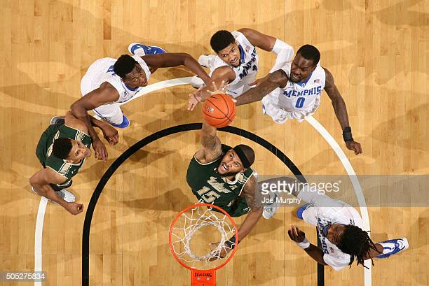 Jaleel Cousins of the USF Bulls jumps for a rebound against Dedric Lawson and Trahson Burrell of the Memphis Tigers on January 16 2016 at FedExForum...