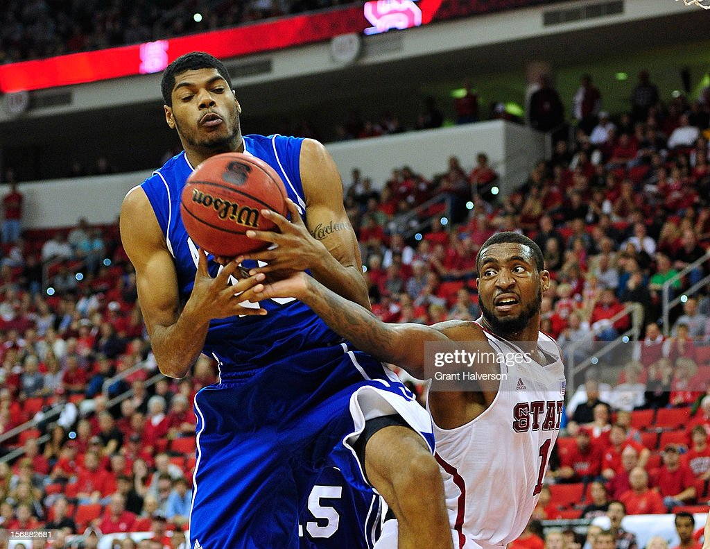 Jaleel Roberts #45 of the North Carolina-Asheville Bulldogs takes a rebound away from Richard Howell #1 of the North Carolina State Wolfpack during play at PNC Arena on November 23, 2012 in Raleigh, North Carolina. North Carolina State won 82-80.