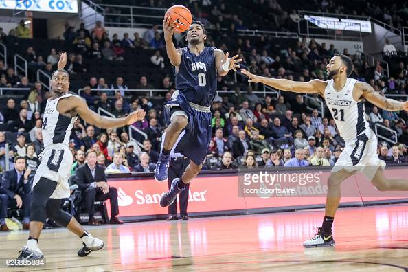 Jaleen Smith Guard for University of New Hampshire shoots the layup during the game between the Providence College Friars and the University of New...