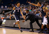 Jalen Adams of the Connecticut Huskies reacts to winning a semifinal game of the 2016 AAC Basketball Tournament against against thethe Temple Owls at...