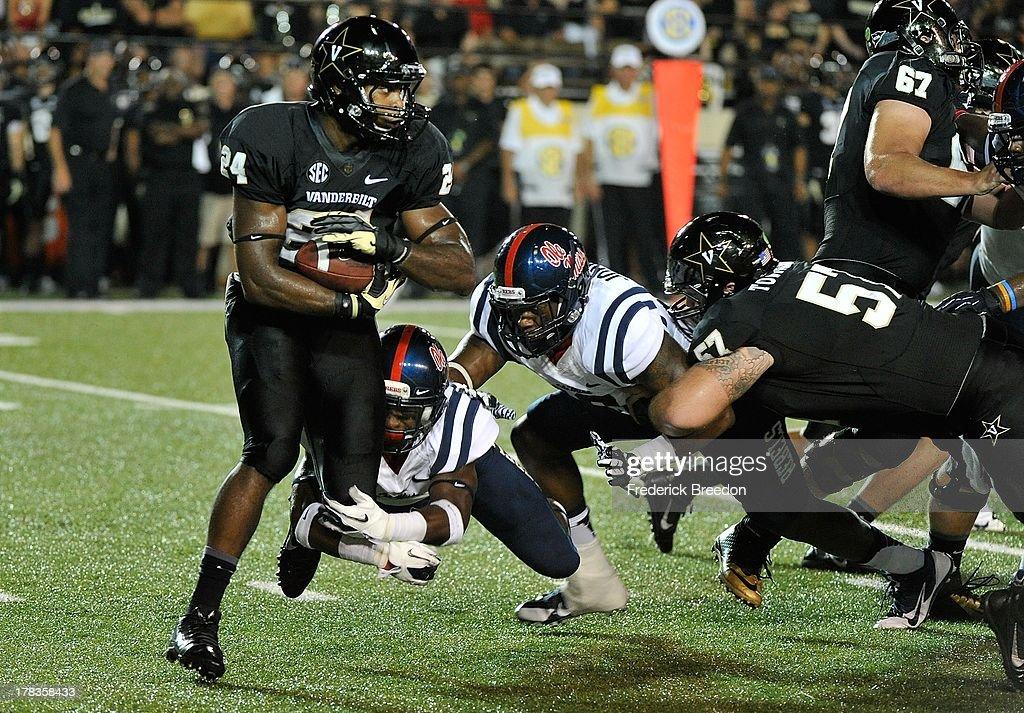 Jalen Banks #24 of the Vanderbilt Commodores rushes against the Ole Miss Rebels at Vanderbilt Stadium on August 29, 2013 in Nashville, Tennessee.