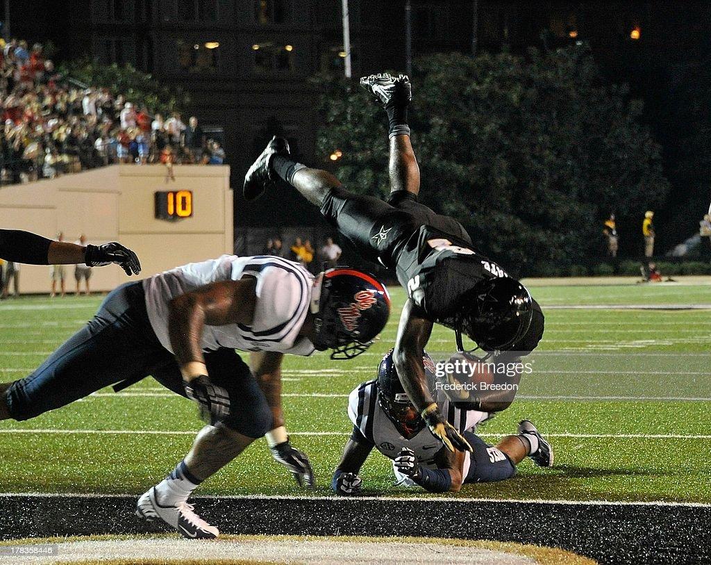 Jalen Banks #24 of the Vanderbilt Commodores scores a touchdown against the Ole Miss Rebels at Vanderbilt Stadium on August 29, 2013 in Nashville, Tennessee.