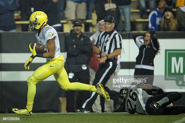 Jalen Brown of the Oregon Ducks eludes Isaiah Oliver of the Colorado Buffaloes as he goes 43 yards for a touchdown pass reception to take a 3824 lead...