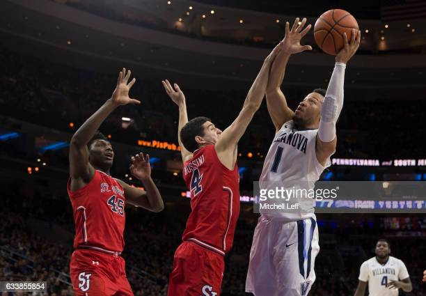 Jalen Brunson of the Villanova Wildcats attempts a shot against Darien Williams and Federico Mussini of the St John's Red Storm in the second half at...