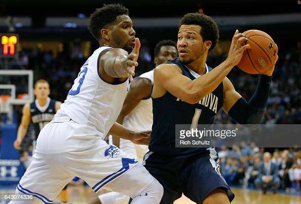 Jalen Brunson of the Villanova Wildcats attempts a shot as Myles Powell of the Seton Hall Pirates defends during the first half of an NCAA college...