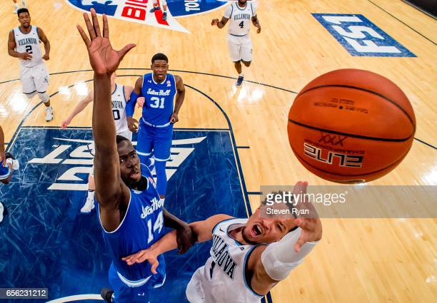 Jalen Brunson of the Villanova Wildcats attempts a shot defended by Ismael Sanogo of the Seton Hall Pirates during the Big East Basketball Tournament...