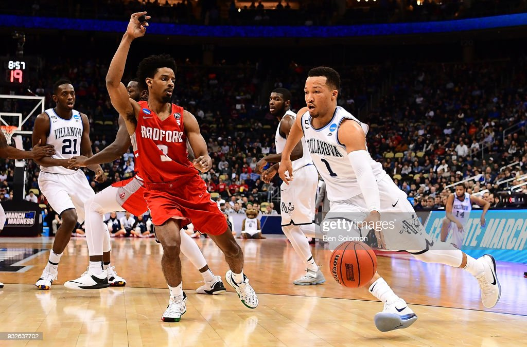 Jalen Brunson #1 of the Villanova Wildcats drives to the basket against Christian Bradford #3 of the Radford Highlanders in the first half during the first round of the 2018 NCAA Men's Basketball Tournament held at PPG Paints Arena on March 15, 2018 in Pittsburgh, Pennsylvania.