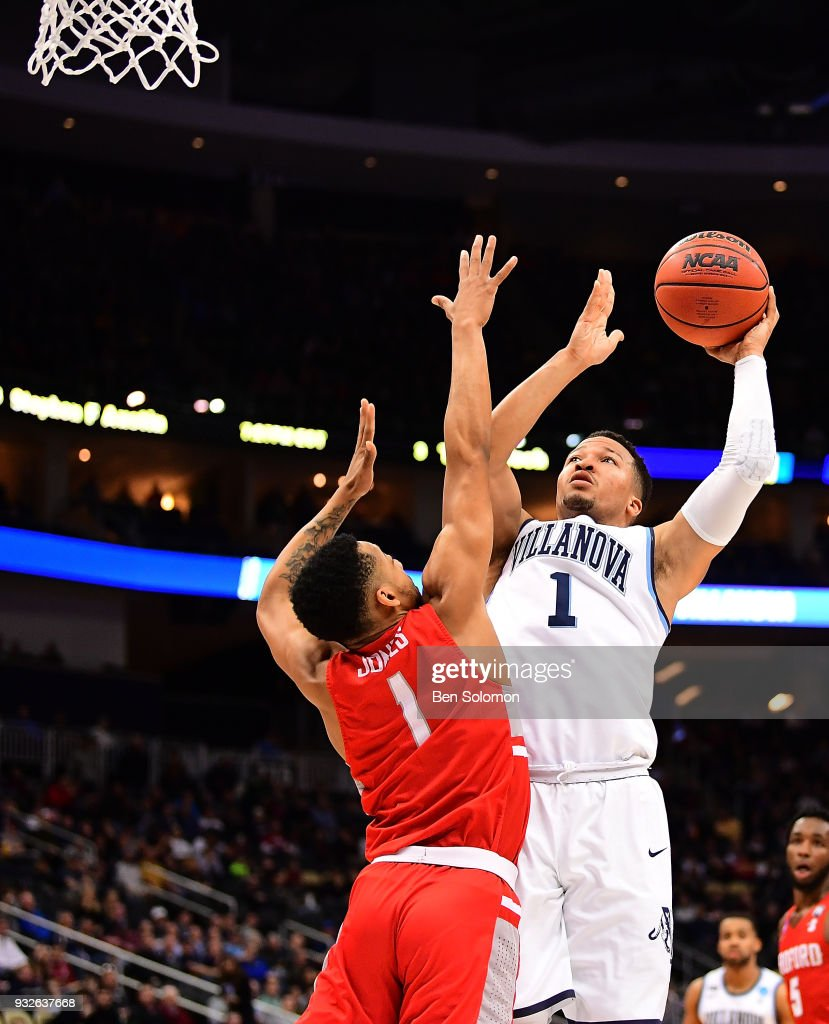 Jalen Brunson #1 of the Villanova Wildcats goes to the basket against Carlik Jones #1 of the Radford Highlanders in the first half during the first round of the 2018 NCAA Men's Basketball Tournament held at PPG Paints Arena on March 15, 2018 in Pittsburgh, Pennsylvania.