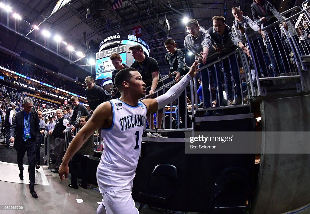 Jalen Brunson #1 of the Villanova Wildcats greets fans as he walks off the court after the Villanova Wildcats defeated the Radford Highlanders 87-61 during the first round of the 2018 NCAA Men's Basketball Tournament held at PPG Paints Arena on March 15, 2018 in Pittsburgh, Pennsylvania.