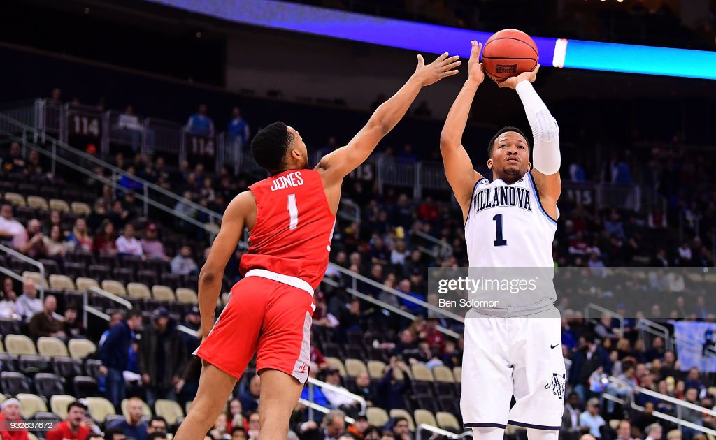 Jalen Brunson #1 of the Villanova Wildcats puts up a jump shot over Carlik Jones #1 of the Radford Highlanders in the first half during the first round of the 2018 NCAA Men's Basketball Tournament held at PPG Paints Arena on March 15, 2018 in Pittsburgh, Pennsylvania.