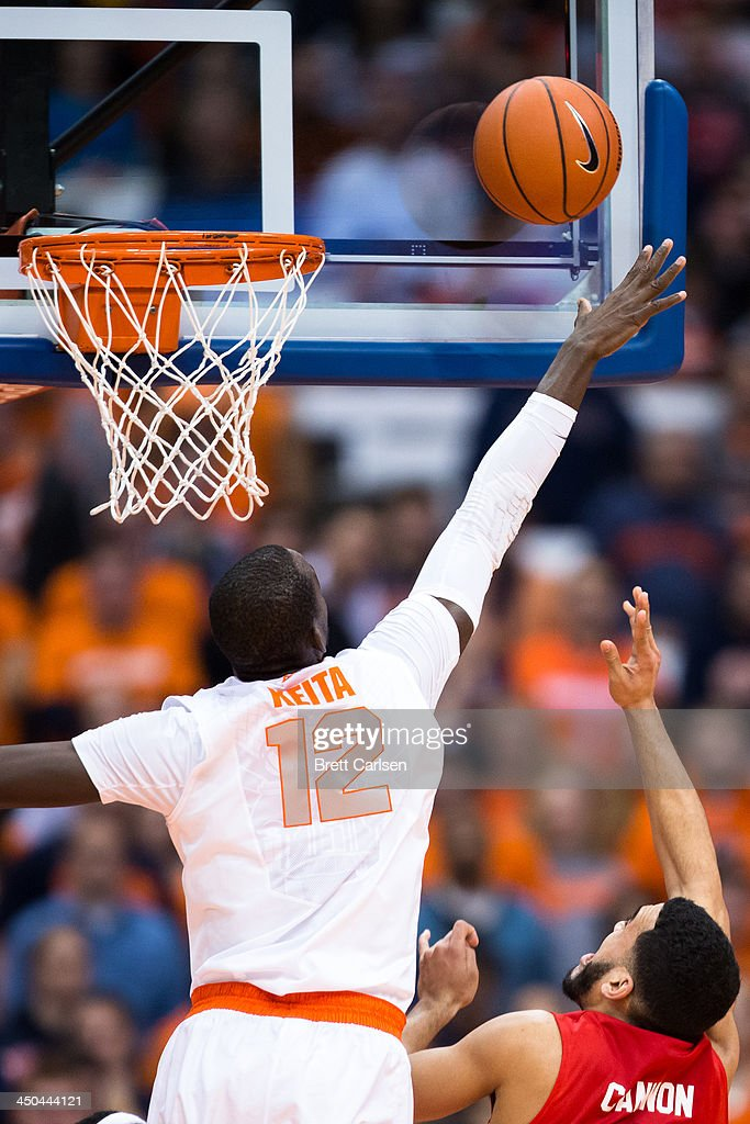 Jalen Cannon #5 of St Francis Terriers sneaks in a first half field goal past Baye Moussa Keita #12 of Syracuse Orange on November 18, 2013 at the Carrier Dome in Syracuse, New York. Syracuse wins 56-50.