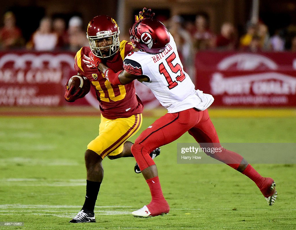 Jalen Greene #10 of the USC Trojans runs after his catch as he is tackled by Dominique Hatfield #15 of the Utah Utes at Los Angeles Memorial Coliseum on October 24, 2015 in Los Angeles, California.