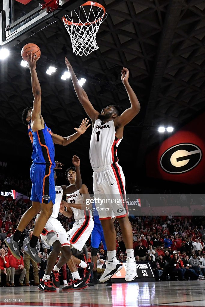Jalen Hudson #3 of the Florida Gators drives to the basket against Yante Maten #1 of the Georgia Bulldogs during the basketball game at Stegeman Coliseum on January 30, 2018 in Athens, Georgia.