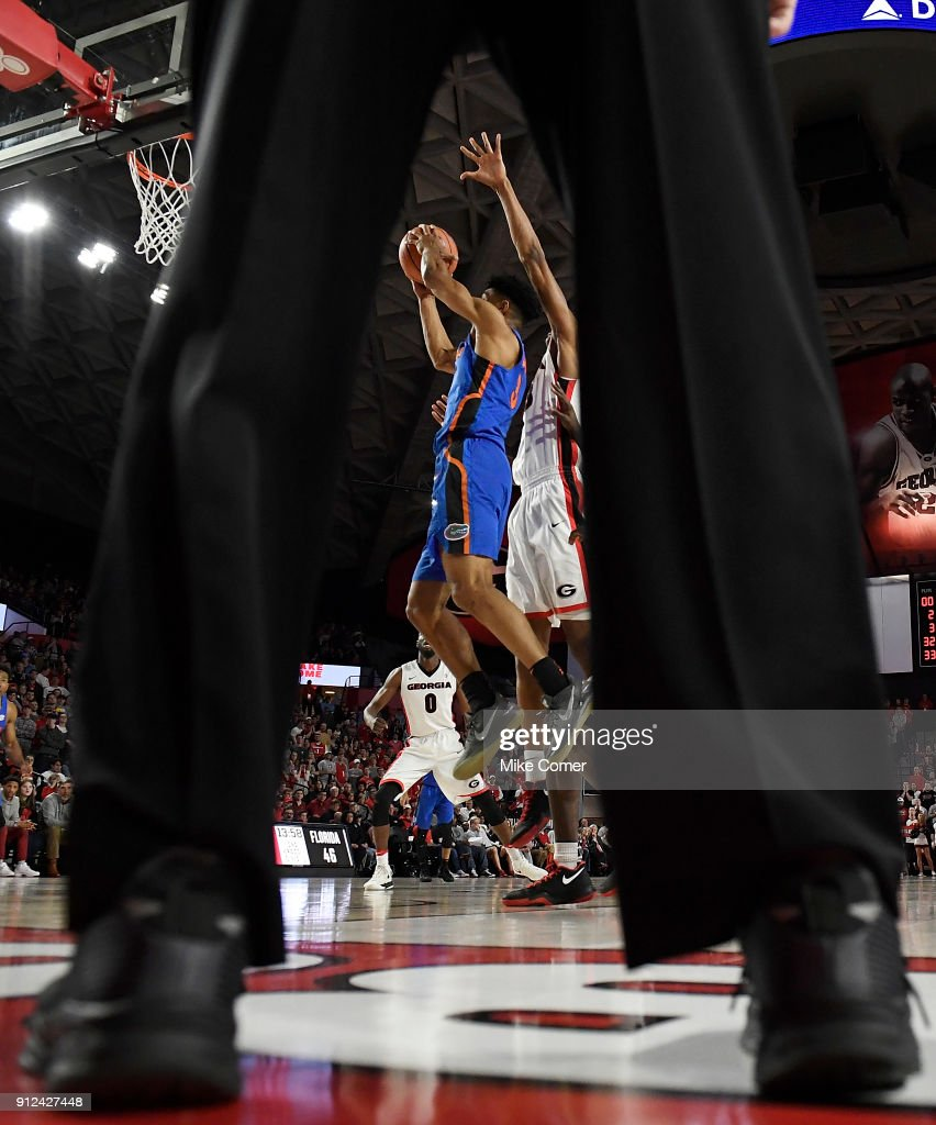 Jalen Hudson #3 of the Florida Gators drives to the hoop past Nicolas Claxton #33 of the Georgia Bulldogs during the basketball game at Stegeman Coliseum on January 30, 2018 in Athens, Georgia.