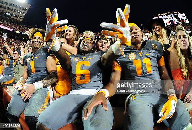 Jalen Hurd Alvin Kamara and Joshua Dobbs of the Tennessee Volunteers celebrate with fans after the game against the Georgia Bulldogs on October 10...